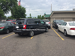 Car with Handicapped Permit Takes 2 Spaces for Room for Life