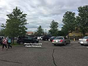 The Grey Car Leaving the Handicapped Spot Struggles to go Back and Forth Several Times To Avoid Hitting the Black Car